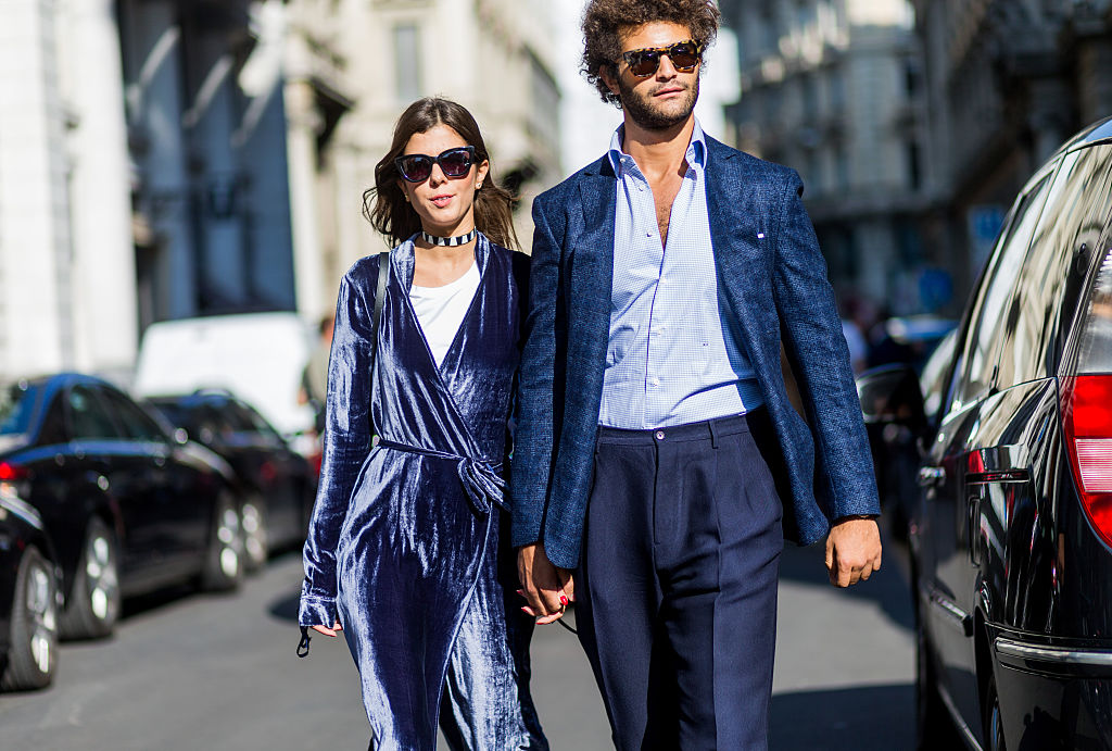 45a42a3d78 MILAN, ITALY - SEPTEMBER 25: A couple wearing a suit and velvet outside  Ferragamo
